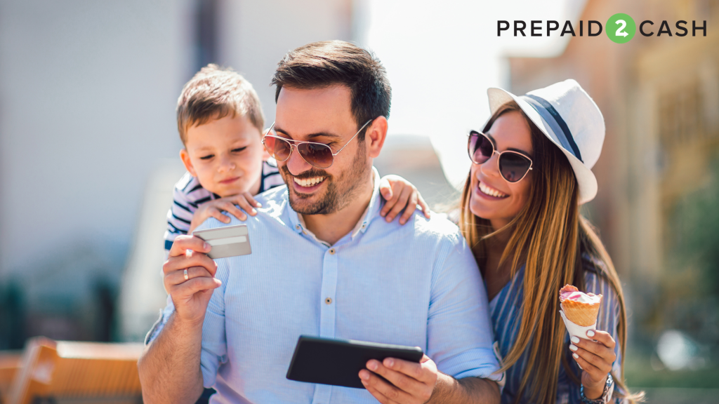Family smiling while looking at gift card