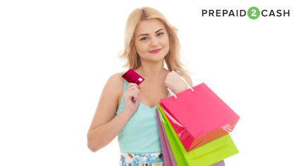Woman with gift card and shopping bags